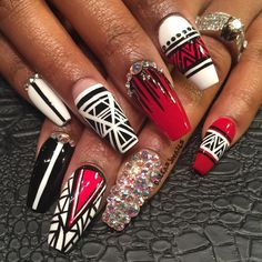She just told me she wanted red black and white! Turned out so dope #dallasjnails #nailart #stlnails #swarvoskinails #swarvoski #matte #stilettonails #nails #longnails #shortnails #dopenails #nails #nailgasm #nailporn #whodidyournails #nailedit #gelnails #bossnails