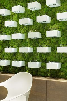 White plastic laminate in a combination with a living wall. Bring the space to live 3d Cinema, Moss Fashion, Find Objects, Optician, Commercial Interiors, Stepping Stones, Sustainability, Eco Friendly, Places To Visit