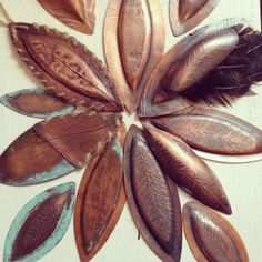 Press Formed copper feather jewellery