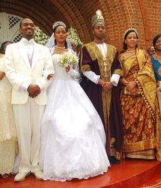 Princess Ruth Komuntale tied a knot with American Christopher Thomas (L) on 17 Nov 2012, on her right is her brother King Oyo of Toro and their mother Queen Best Kemigisa