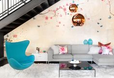 Turquoise Egg chair blends in seamlessly with the chic decor in a teenage girls' room