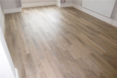 """Karndean KP99 Lime Washed Oak Knight Tile Vinyl Flooring looks like worn, sun-bleached driftwood. A good selection varied plank colours, and supplied in a 6"""" wide plank for an authentic look.<br /><br />If you'd like to use Design Strips with your LVT floor you can use <a href=""""/advice/how-many-design-strips"""" target=""""_blank"""">this page</a> to calculate how many boxes to buy."""