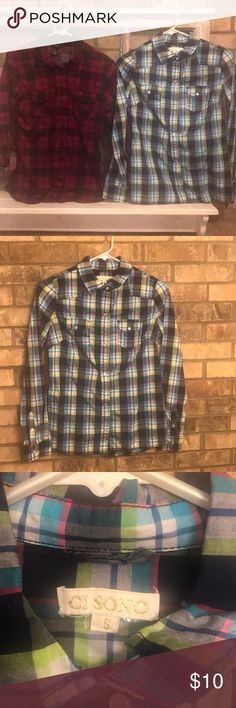 🚨🚨 Two for One Flannels! 🚨🚨 Two flannels for the price of one!! Bundle with other items in my closet and save on shipping!   Maroon and black flannel is 100% polyester. Small signs of wear but still a lot of life left.  Blue flannel is 100% cotton. No wear on this flannel! Like new condition. Tops Button Down Shirts