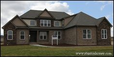 3560 Sq Ft NC custom home with 6 bedrooms, 3 bathrooms. Brick and stone exterior with dormer accents.