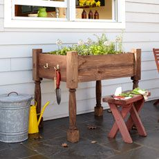 a finished raised herb-garden planter