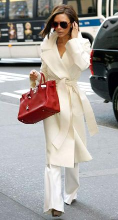 Love how the red purse pops against the white.