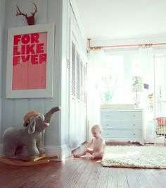 Aww my little guys room has a rocking grey elephant and vintage white rug as well. Love these colours.