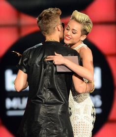 Miley Cyrus shares the same hairstyle as Justin Bieber.