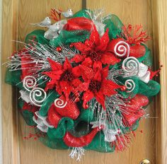 Christmas Wreath!  Traditional glittery red, green and silver deco mesh wreath.  Made with emerald green deco mesh, red deco ribbon, silver ribbon, lots of silver and red picks, silver birds and red poinsettias.