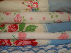 Vintage pillow cases. Looks like this picture was taken of the linen closet down the shore...I know for sure that we had  the roses one with the pink dots.