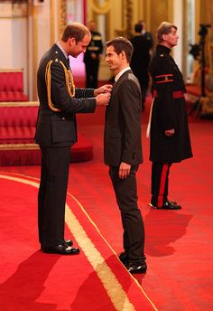 Prince William awarding British tennis player Andy Murray with his OBE honour