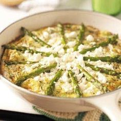 Yum. Feta Asparagus Frittata (I used milk instead of cream, egg whites instead of eggs) next time i'll try it with smoked salmon!