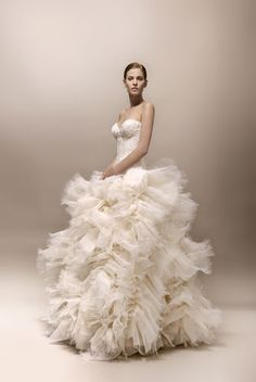 Collection Max Chaoul 2013 ruffled designer French bridal gown #weddingdress Interesting. Definitely unique. It looks like she's spinning in this picture, and I kinda wish I could see how it sits normally