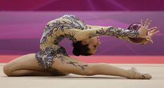 Rhythmic Gymnastics - Day 1 - Rhythmic Gymnastics Slideshows | NBC Olympics.   Egypt's Yasmine Mohmed Rostom performs during the rhythmic gymnastics individual all-around qualifications at at the 2012 Summer Olympics, Thursday, Aug. 9, 2012, in London. (AP Photo/Gregory Bull)