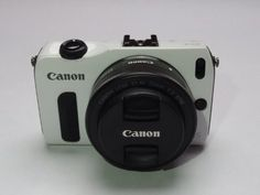 Canon EOS M Compact System Camera - Body Only (White), http://www.amazon.com/dp/B00B5GT37Y/ref=cm_sw_r_pi_awdm_JS1Fub0WVXWRM