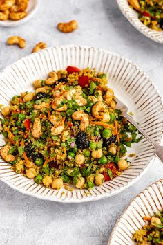 Vibrant curry cashew chickpea quinoa salad packed with veggies and delicious flavor from curry powder, fresh ginger, turmeric and sweet and spicy maple glazed cashews. This wonderful vegan curry chickpea quinoa salad is easy to make for the perfect main meal or healthy side dish!