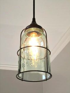Rustic Half Gallon Caged Mason Jar Pendant Light - farmhouse, unique, industrial, lighting, pendant light, kitchen light by OutoftheWdworkDesign on Etsy https://www.etsy.com/listing/259534994/rustic-half-gallon-caged-mason-jar