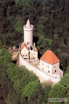 Czech Kokořín Castle lies in the middle of a nature reserve on a steep rocky…