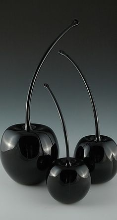 glossy: the photograph is being shown with a glossy theme and showing the cherries are showing a reflection of each other