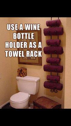 Use a wine rack as a towel rack