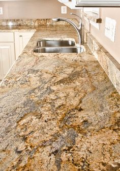 Yellow River Granite is a subtle, but complex stone with a lilting pattern of gold, brown, caramel, black, white, and cream over a gray background. It is quarried in Brazil. It varies a good deal from slab to slab so make sure you pick out the particular slab for your project.