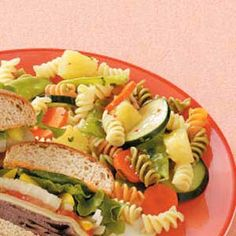 Colorful Pasta Salad Recipe -The colorful side dish shared by Mary Tallman of Arbor Vitae, Wisconsin features sweet pineapple, crunchy vegetables and refreshing cilantro in a tangy dressing with pasta. It requires just 15 minutes of prep time, so it's perfect for a quick lunch or on-the-go dinner.