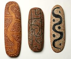 Central Australian Decorated Shields. Carved and fluted beanwood (Erythrina vespertilio) with applied earth pigments. Image: Ben Healley Source: Museum Victoria
