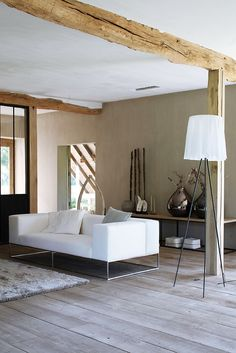 Plaster walls and exposed beams add warmth