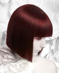 A short red straight coloured Womens hairstyle by Craig Chapman