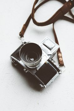 1924us:  Working with film x The Exakta VX German engineered 35mm.This is a beauty and was the same camera featured in the breathtaking movie; Extremely Loud and Incredibly Close.It's available in our shop here.Strap by Stock & Barrel Co.