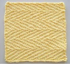 Herringbone Linen Knit Dishcloth Pattern | This herringbone textured dishcloth knitting pattern looks perfect in yellow.