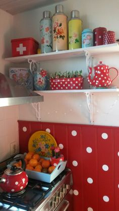 Polkadot kitchen by Mo's. ☆☆ Nice, inexpensive way to include polka dots in your kitchen. Paint beadboard red, then add white polka dots.
