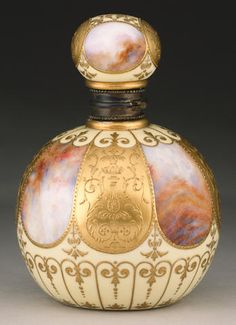 Lot Details A Coalport scent bottle and stopper circa 1898 decorated with alternating raised gold and agate glazed segmental panels, all on a yellow ground with further raised gilt scrolls, and a gilt metal hinged mount,