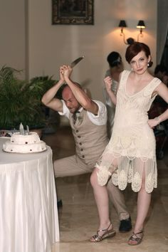 What a cute 1920s wedding look this couple has (but her shoes better have been changed for comfort, those are not workin for me) ...funny cake cutting picture.