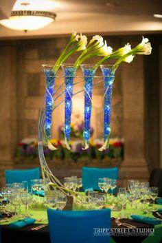 These Bar Mitzvah centerpieces were in modern glass tubes.