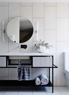 Contemporary #bathroom with clean white #tile and modern vanity