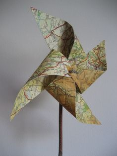 old map pinwheels with natural stick - set of 3. £6.50, via Etsy.