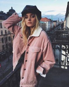 Oversized pink jacket with shearling collar and cute black hat.