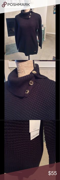 NWT Calvin Klein waffle knit tunic sweater Such a cute black sweater. Absolutely brand new and never worn. It has gold button accents on the neck with the Calvin Klein logo and and a gold logo accent on the hem. Reasonable offers welcomed! 👍⭐️❤️ Calvin Klein Collection Sweaters