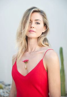 Designer of Fleurings, actress Samantha Lockwood, wears the small vase necklace which comes in gold, pink gold, black, steel and silver