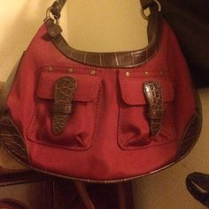 Authentic Red and brown leather shoulder bag NEW. NEVER USED. STILL HAS PLASTIC COVERING ON IT. Bags Shoulder Bags