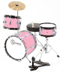 """Pink Drum Set Junior Kids Complete Kit with Cymbal Stool and Sticks by Gammon Percussion. $79.95. High Gloss Pink: This top selling junior drum set comes with everything you need to start playing included -   12"""" Bass Drum with 6 lugs,   Hanging Tom with 4 Lugs,   Snare Tom with 4 Lugs, Bass Drum Pedal,  8"""" Cymbal,  Drummer's Throne (stool),  Pair of  Sticks & Drum Key. Some assembly is required and instructions are included.  This will make a perfect gift for any aspiring yo..."""