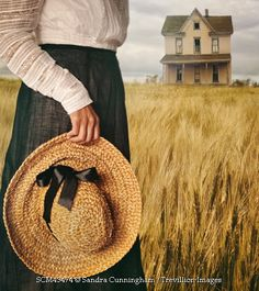 Trevillion Images - historical-woman-in-field-by-large-house