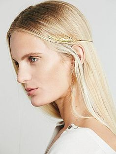 Bohemia Feather Headpiece | Designed to sit around the back of your head, this enchanting gold ring headpiece features two lovely gold feathers to line your locks. U-design with open back.  *By Regal Rose