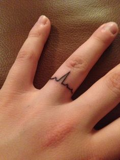 Got a normal EKG ring design with my husband. My first tat and now I want more!