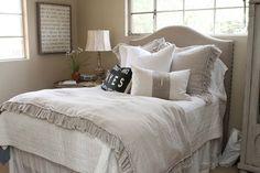 linen headboard, white bedding, gorgeous pillows