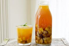 Mango + Plum Sweet Tea Cocktail from A Beautiful Mess - This looks perfect for patio drinking!