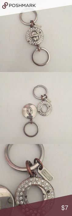 Coach Valet Silver Rhinestone Key Ring USED. Coach Valet Key Chain. Middle turn lock. 2 missing rhinestones in middle. Tarnishing shown other wise in good condition. Convenient to helpfully separate keys. Coach Accessories Key & Card Holders