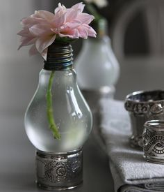 Recycled Light bulb vase - use napkin ring or egg holder to set them on. Paint some designs on and WALA!