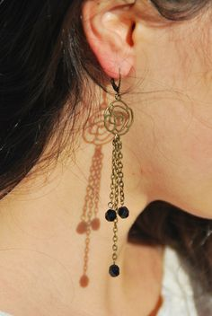 Stylish Antique Brass flower chain earrings with black glass beads.